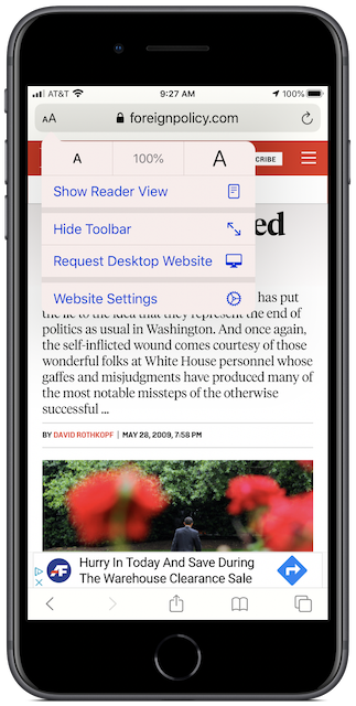 "Default view in Safari on an iPhone, with AA menu showing ""Show Reader View."""